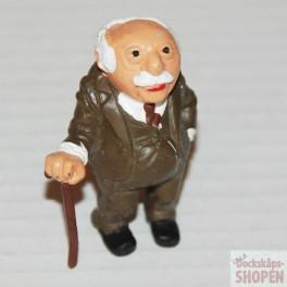 Figur från Mupparna äldre herre Statler med käpp