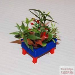 UM2+ Blombytta med blommor blå röd